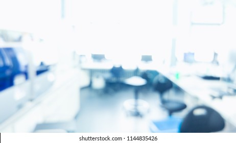 Laboratory interior out of focus. blur image of modern medical, biological or chemical laboratory with next generation sequencer. pharmacy background. template for poster or webpage.