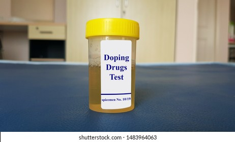 Laboratory sample of urine for doping test. Doping is the used of banned athletic performance enhancing drug by athlete in competitive sport. Medical test in sport medicine concept.
