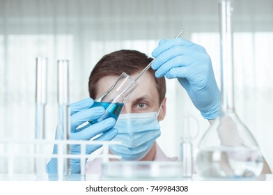 Laboratory scientist working at lab with test tubes.