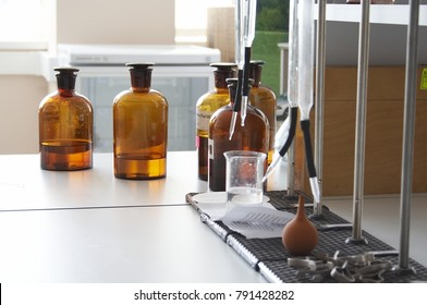 Laboratory table with pretty, colorful bottles.