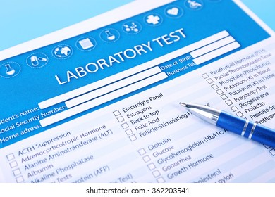 Laboratory test list with pen on blue background, close up