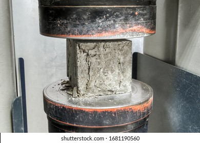 Laboratory for testing building materials. Concrete cube after a compressive strength test. The test sample cracked.
