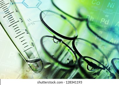Laboratory tools in green tone. Chemical or medical theme.