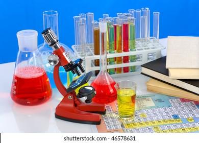 Laboratory ware, microscope and books