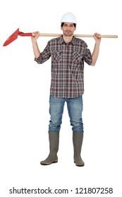 Laborer holding shovel