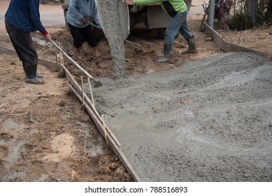laborers made new construction of street and floor by cement concrete