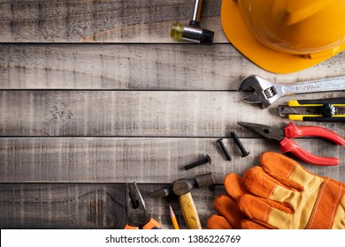 Labour Day,  Many handy tools on wooden background texture.
