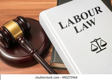 Labour law book and gavel. Consumer protection book and gavel. Law and regulations concept.