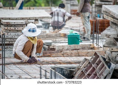 The labour is unskilled worker that install wire for construction work to build a home.