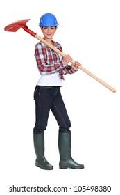Labourer carrying a spade