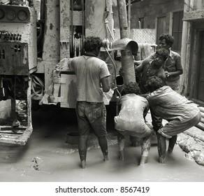 labourers at construction site, delhi, india
