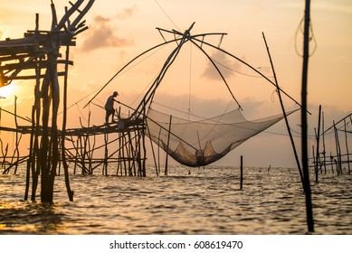 Labour-intensive fishing technique by using giant nets in the south of Thailand. The net is descended into the water for a short time and then raised by pulling on the ropes