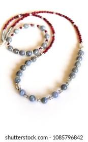 Labradorite and wine red garnet gemstone necklace isolated on white background