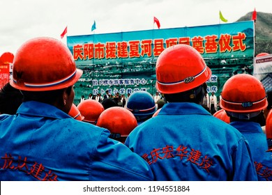 Labrang Monastery, Xiahe, Gansu Province / China - JUN 6 2011: workers are waiting lined up for an official governmental announcement and presentation around the temple