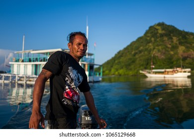 Labuan Bajo, Indonesia - April 01, 2018: Local man on boat in Labuan Bajo harbour