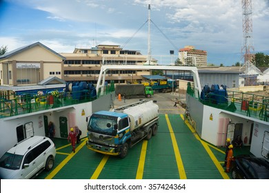 LABUAN FT, MALAYSIA - DEC 26, 2015: Ferry with vehicles on board in the morning, carries passengers and vehicles to Menumbok, Sabah. This is the economical transportation to the Borneo hinterland.