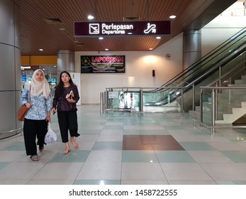 Labuan, Malaysia. December 5, 2018. Passangers walking at a lobby of Labuan Airport