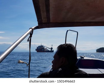 Labuan, Malaysia - December 6, 2018. Offshore worker riding a water taxi to Labuan Anchorage to board a vessel for inspection