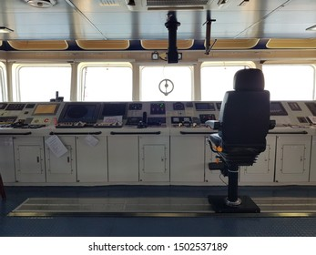 Labuan, Malaysia - December 6, 2018. A control panel on a bridge of a ship anchored at Labuan outer port anchorage waiting for an inspection by client