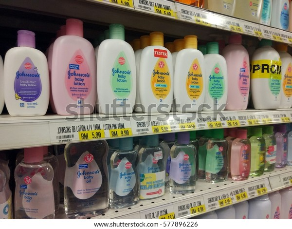 Labuan, Malaysia - February 13, 2017: View of various Johnson's Baby product on the shelves of supermarket.It is an American brand of baby cosmetics and skin care products owned by Johnson & Johnson.