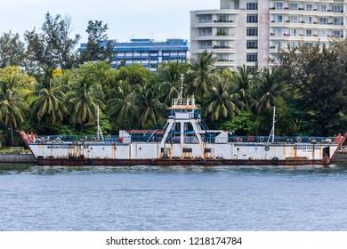 Labuan, Malaysia -  March 5 2018: Decommissioned Ro-Ro Passenger Ship WARISAN PERDANA (IMO 8026256, 1983) mooring in Labuan Harbour.