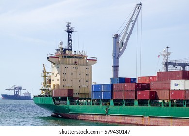 Labuan,Malaaysia-Feb 8,2017:Loaded cargo container ship at its moorings in Labuan port,Malaysia.The port can handle a higher volume of cargo with an advanced cargo tracking system & storage