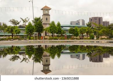 Labuan,Malaysia-Apr 5,2019:View of Labuan Clock Tower located at Sea Sport Complex with background of Financial Park Labuan building in Labuan,Malaysia.