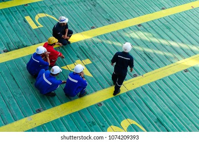 Labuan,Malaysia-April 6,2018:Ferry ship sailors wearing overall and hard hat working during mooring operation in Labuan,Malaysia.