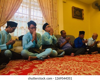 Labuan,Malaysia-Dec 29,2018:Muslim people hands praying for the prayers for the deceased in Labuan,Malaysia.They pray the dead by reciting sentences and some Suras of the Quran.