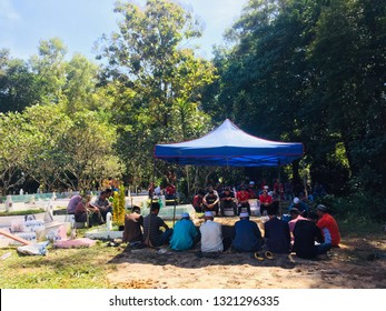 Labuan,Malaysia-Feb 22,2019:Muslim pray at a islamic grave during a funeral in Labuan island,Malaysia. The community joins in as it is part of Islamic traditions.