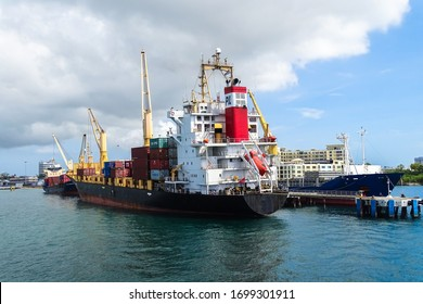 Labuan,Malaysia-Feb 26,2020:View of busy port with container ships in Labuan Pearl of Borneo,Malaysia.Container ship in export and import business logistics.