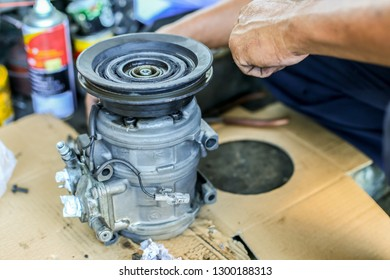 Labuan,Malaysia-Jan 28,2019:View of car air conditioning compressor under service by mechanic in Labuan,Malaysia.AC Compressor costs will change from car to car among many other variables.