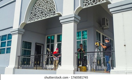 Labuan,Malaysia-June 21,2020:People watch through a telescope into the sky at a partial solar eclipse in Labuan,Malaysia.