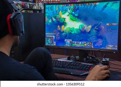 Labuan,Malaysia-March 29,2019:Young people playing video games Dota 2 in cyber cafe at Labuan,Malaysia.It is a multiplayer online battle arena video game developed & published by Valve Corporation.