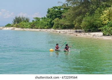 Labuan,Malaysia-May 1,2017:Group of tourist enjoying kayaking with the transparent kayak in Rusukan Besar island,Labuan,Malaysia.Labuan is the ideal place for water sports,like kayaking & scuba diving