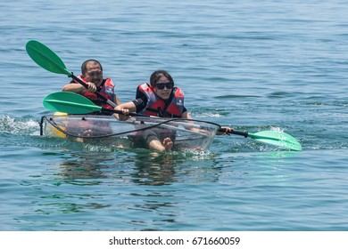 Labuan,Malaysia-May 1,2017:Tourist enjoying the kayaking with the transparent kayak in Rusukan Besar island,Labuan,Malaysia.Labuan is the ideal place for water sports,like kayaking & scuba diving