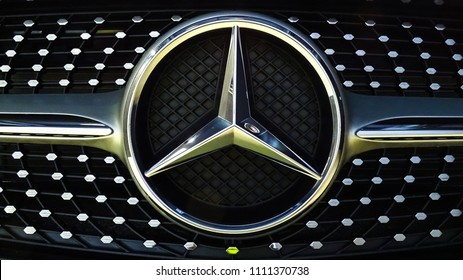 Labuan,Malaysia-May 13,2018:Closeup of Mercedes Benz logo on black Mercedes Benz CLA 200 at motor show Labuan,Malaysia.It is powered by a 1.6-litre turbo four-cylinder good for 115kW and 250Nm.