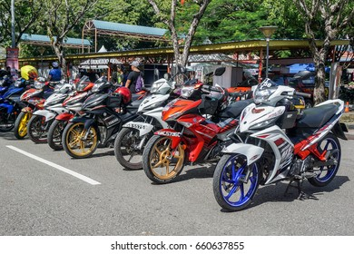 Labuan,Malaysia-May 21,2017:Daily life of Labuan people with motorcycle parking at Labuan island,Malaysia. Motorbikes are popular vehicles for local people in this islander.