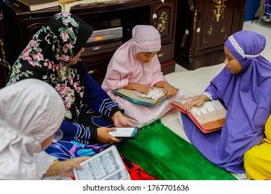 Labuan,Malaysia-May 21,2020:Malaysian muslim kids reading the holy Quran to celebrate the holy Ramadan Kareem feasting month in Labuan,Malaysia.