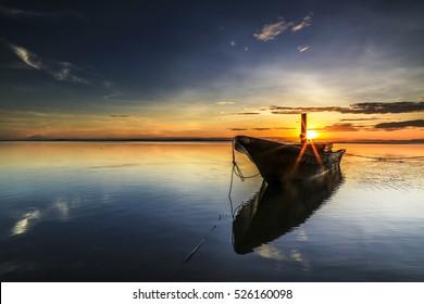 Labuan,Malaysia-November 30,2016:Fisherman boat at Labuan Pearl Of Borneo,Malaysia on last of November 2016 during beautiful sunrise at Labuan tropical island,nature background. Part one