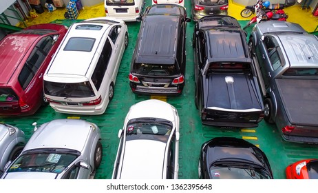 Labuan,Malaysia-Sept 1,2018:Car parked in a row at parking lot of ferry bot in Labuan,Malaysia.All imported and locally assembled vehicles registered in Langkawi and Labuan were free of duty or tax.