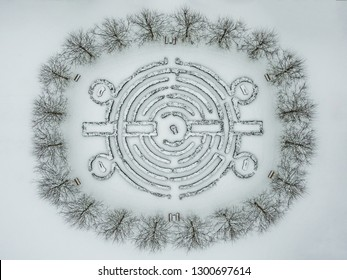 A labyrinth drawn in the winter by a dron