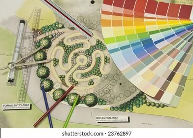 Labyrinth Landschaft Design mit einem Farbrad und Zeichenwerkzeuge.