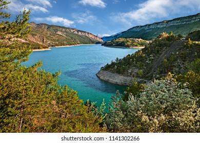 Lac de Castillon, Provence, France: landscape of the lake, mountains and the village Saint-Julien-du-Verdon in the Verdon nature park