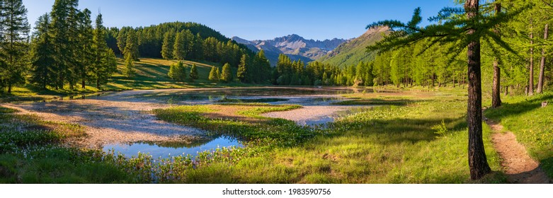 Lac de Roue lake in the Queyras Nature Park late Spring -early Summer (panoramic). Hiking site near Arvieux in the Hautes-Alpes, French Alps, France - Shutterstock ID 1983590756