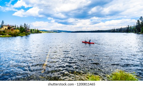 Lac Le Jeune, British Columbia, Canada - Sept. 1, 2019: Two Man kayaking on Lac Le Jeune near Kamloops