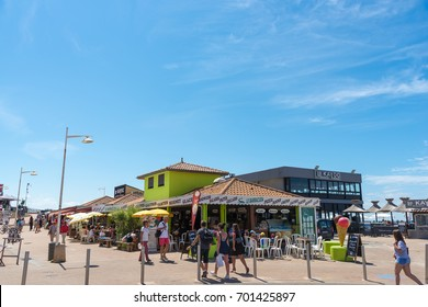 LACANAU, FRANCE - AUGUST 12, 2017: beachfront buildings, shops and restaurants in Lacanau, a French seaside resort on the Atlantic Coast and a well-known surf station close to the Arcachon Bay.