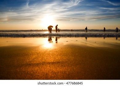 LACANAU, FRANCE - August 29, 2016: Silhouettes of people at the beach at sunset