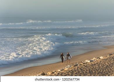 Lacanau (France), surfers on the beach
