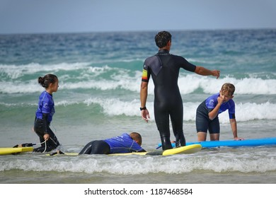 Lacanau-Ocean, France - August 2018: Surf school students in action